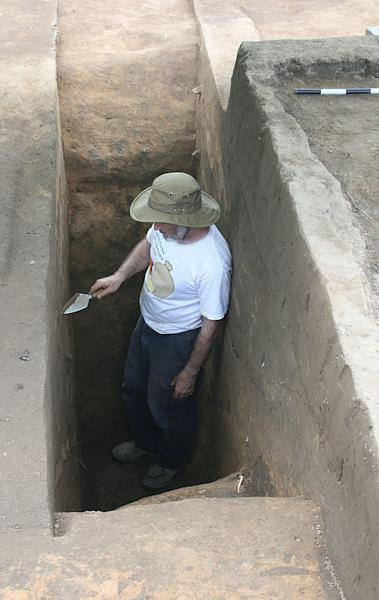 Archaeologist Robin Beck at the base of the Spanish moat, which measured is 5.5 feet (1.7 m) deep and 15 feet (4.5 m) across.