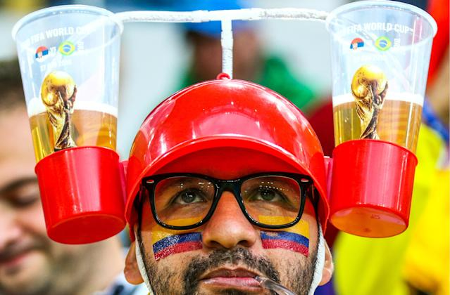 <p>A supporter of Team Colombia drinking beer ahead of the 2018 FIFA World Cup Round of 16 match between Colombia and England at Spartak Stadium. Mikhail Tereshchenko/TASS (Photo by Mikhail Tereshchenko\TASS via Getty Images) </p>