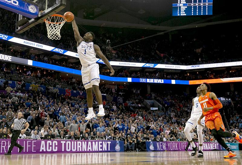 Duke's Zion Williamson (1) glides to the basket for a dunk in the opening minutes of play against Syracuse in the quarterfinals of the ACC Tournament at the Specturm Center in Charlotte, N.C., on Thursday, March 14, 2019. (Robert Willett/Raleigh News & Observer/TNS via Getty Images)