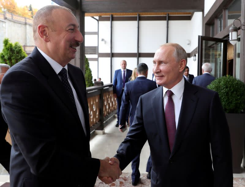 FILE PHOTO: Russia's President Putin shakes hands with Azerbaijan's President Aliyev during their meeting in Sochi