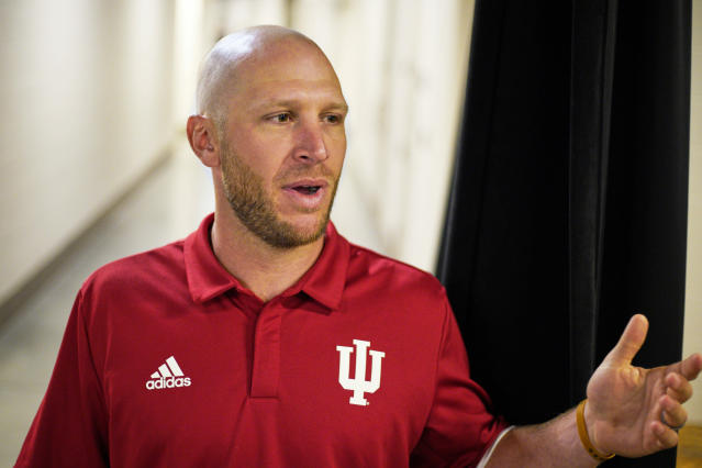 Indiana coach Jeff Mercer gestures at the conclusion of a news conference, Tuesday, May 21, 2019, ahead of the Big Ten NCAA college baseball tournament. First-year coach Mercer led the Hoosiers to their first Big Ten regular-season championship since 2014. His team leads the nation with 90 home runs entering the conference tournament at TD Ameritrade Park in Omaha, Neb. (AP Photo/Nati Harnik)
