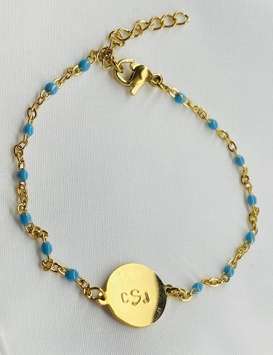<p>This <span>Jewelry Ave Studio Gold Monogram Charm Bracelet</span> ($14) is colorful in the most subtle way, so if you're someone who's considering adding more color to your collection, it's a great place to start.</p>