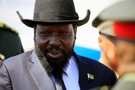 FILE PHOTO: South Sudan's President Salva Kiir Mayardit reacts upon arrival at Khartoum airport, Sudan