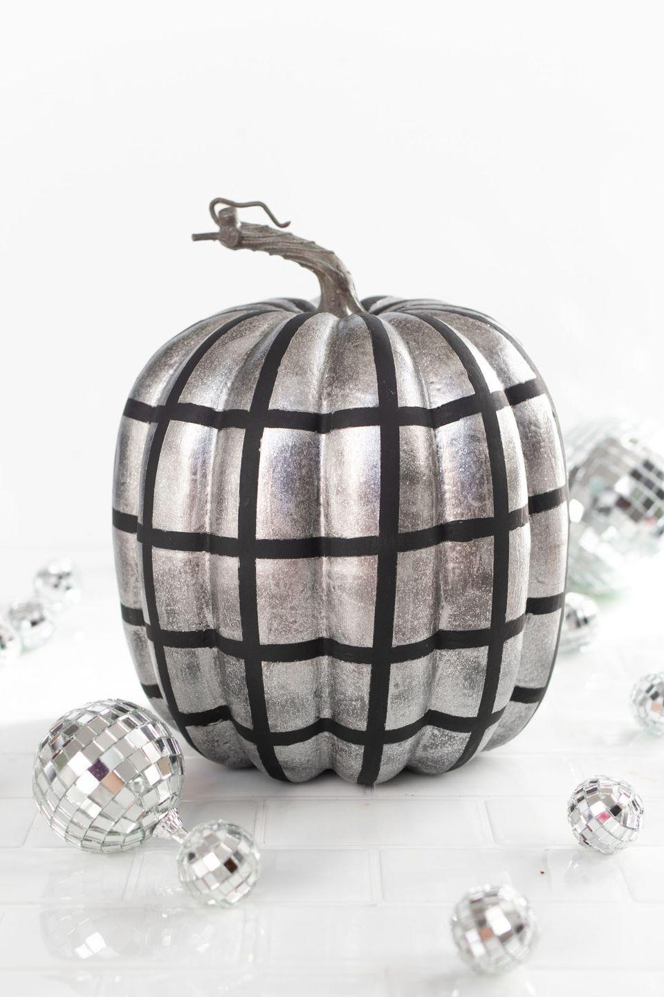 """<p>Stick this metallic pumpkin outside your door to show party-goers what they can expect when they step inside: music, dancing, and tons of sparkle. </p><p><em><a href=""""https://www.clubcrafted.com/disco-ball-pumpkin/"""" rel=""""nofollow noopener"""" target=""""_blank"""" data-ylk=""""slk:Get the tutorial at Club Crafted »"""" class=""""link rapid-noclick-resp"""">Get the tutorial at Club Crafted »</a></em></p>"""