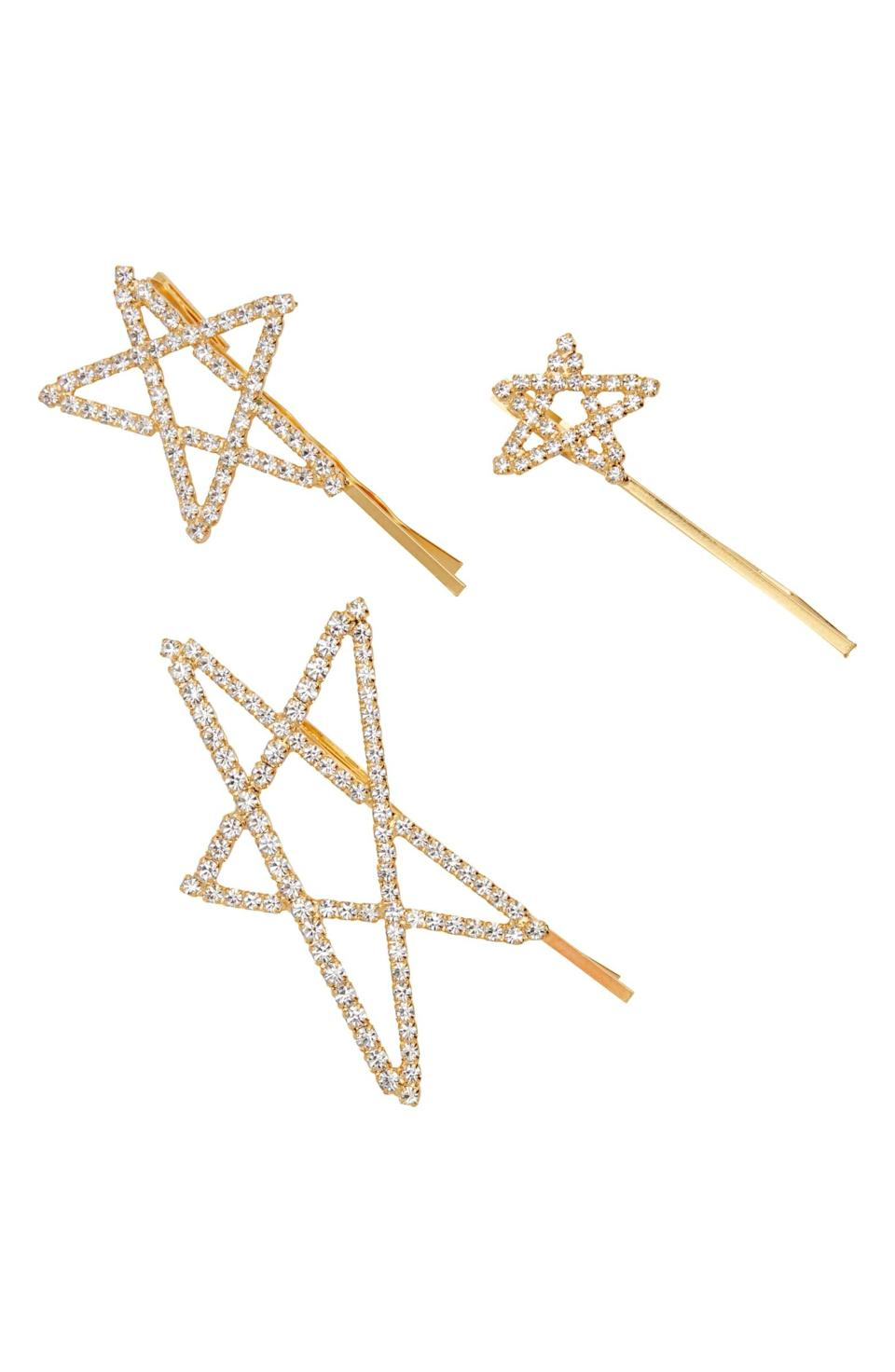 """<p>Embrace your inner star with these delicate bedazzled hair clips. Each rhinestone clip is a different size — perfect for mixing, matching, and stunting on the 'Gram. Wear one, two, or all three clips for a look you'll want to repeat all summer long.</p> <p><strong>$188</strong> <strong>for three clips</strong> (<a href=""""https://www.olivela.com/products/lelet-ny-seeing-stars-bobby-pin-set-432537?campaignId=10253643819&gclid=EAIaIQobChMIoKDGvJru6wIVjbbICh0fXgdKEAQYAyABEgIL1fD_BwE"""" rel=""""nofollow noopener"""" target=""""_blank"""" data-ylk=""""slk:Shop Now"""" class=""""link rapid-noclick-resp"""">Shop Now</a>)</p>"""