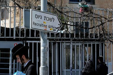 An Ultra-Orthodox Jewish man walks past the entrance to the Israeli military recruiting office in Jerusalem, March 13, 2018. REUTERS/Ronen Zvulun