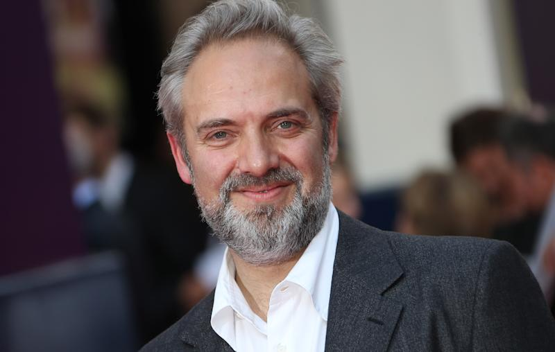 """FILE - In this June 25, 2013 file photo, director Sam Mendes arrives for the opening night of the musical """"Charlie and the Chocolate Factory,"""" at the Drury Lane Theatre in central London. Mendes is coming back to direct another James Bond film with Daniel Craig following the enormously successful """"Skyfall."""" Mendes had suggested """"Skyfall"""" would be his lone entry in the 007 canon, but Bond producers and Sony Pictures announced his return Thursday, July 11. (Photo by Joel Ryan/Invision/AP, File)"""