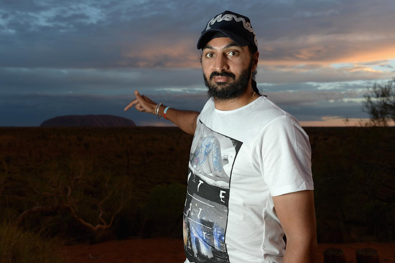 AYERS ROCK, AUSTRALIA - NOVEMBER 26:  Monty Panesar of England poses for a photograph during a team visit to Uluru, which is also known as Ayers Rock, on November 26, 2013 in Ayers Rock, Australia.  (Photo by Gareth Copley/Getty Images)