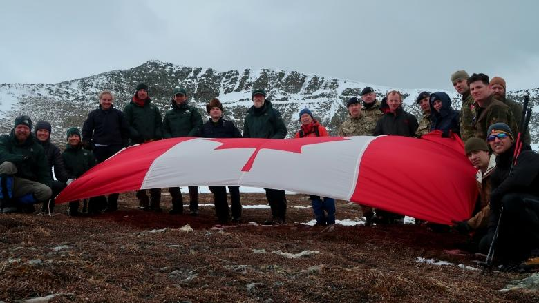 Soldiers, police and parks staff hike up mountain to reach Canada's Vimy Ridge