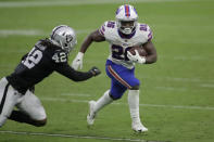 Buffalo Bills running back Devin Singletary (26) runs against Las Vegas Raiders inside linebacker Cory Littleton (42) during the second half of an NFL football game, Sunday, Oct. 4, 2020, in Las Vegas. (AP Photo/Isaac Brekken)