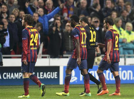 Barcelona's players leave the pitch after their Champions League group H soccer match against Ajax Amsterdam at Amsterdam Arena November 26, 2013. REUTERS/Toussaint Kluiters