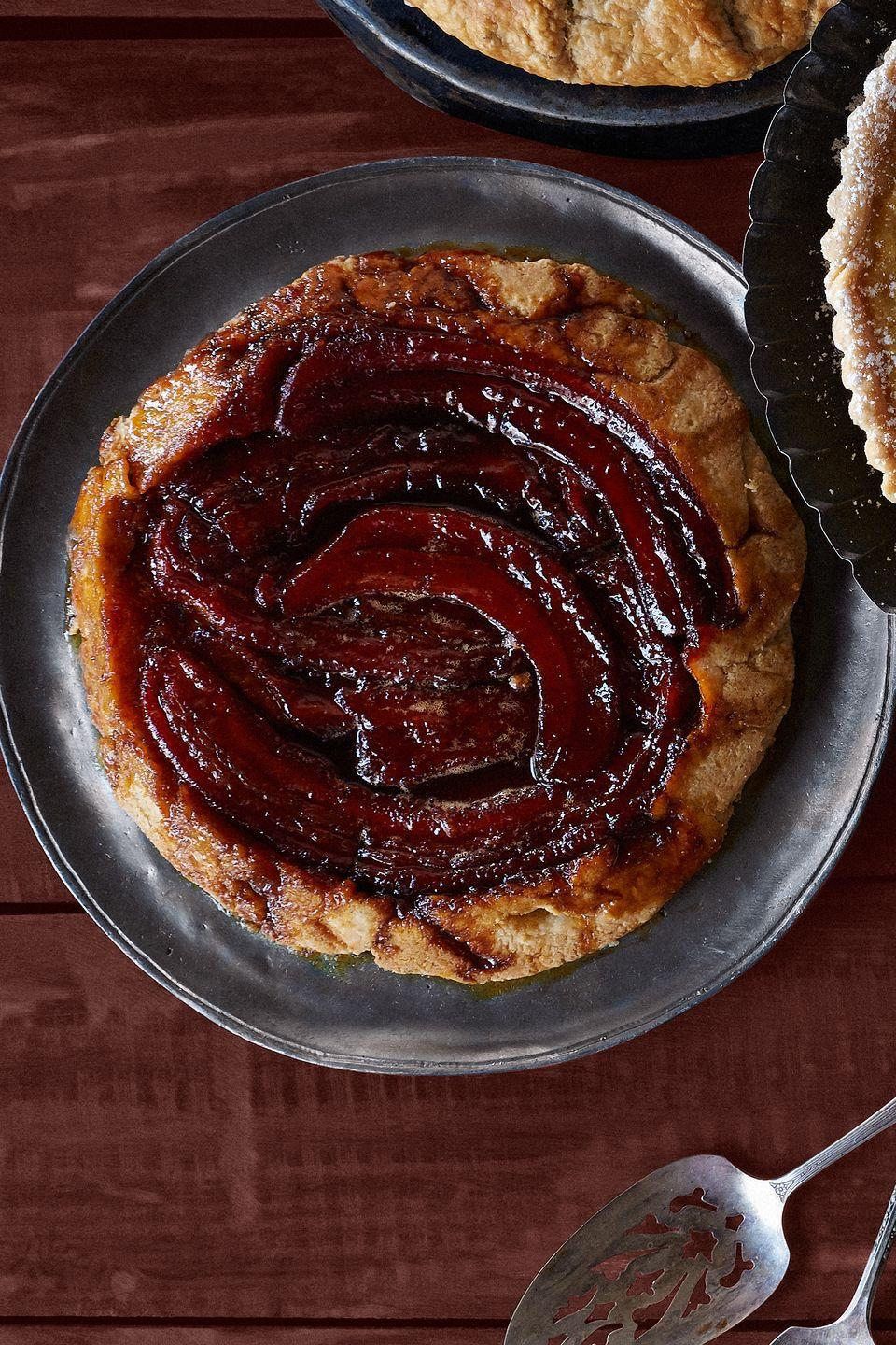 """<p>This skillet dessert will impress your guests with its hearty dose of banana flavor.</p><p><span><strong><a href=""""https://www.countryliving.com/food-drinks/recipes/a36556/banana-tart-tatin/"""" rel=""""nofollow noopener"""" target=""""_blank"""" data-ylk=""""slk:Get the recipe"""" class=""""link rapid-noclick-resp"""">Get the recipe</a>.</strong></span><br></p>"""
