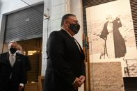 U.S. Secretary of State Mike Pompeo visits the Jewish Museum in the northern city of Thessaloniki, Greece, Monday, Sept. 28, 2020. Pompeo said Monday the United States will use its diplomatic and military influence in the region to try to ease a volatile dispute between NATO allies Greece and Turkey over energy rights in the eastern Mediterranean. (AP Photo/Giannis Papanikos, Pool)