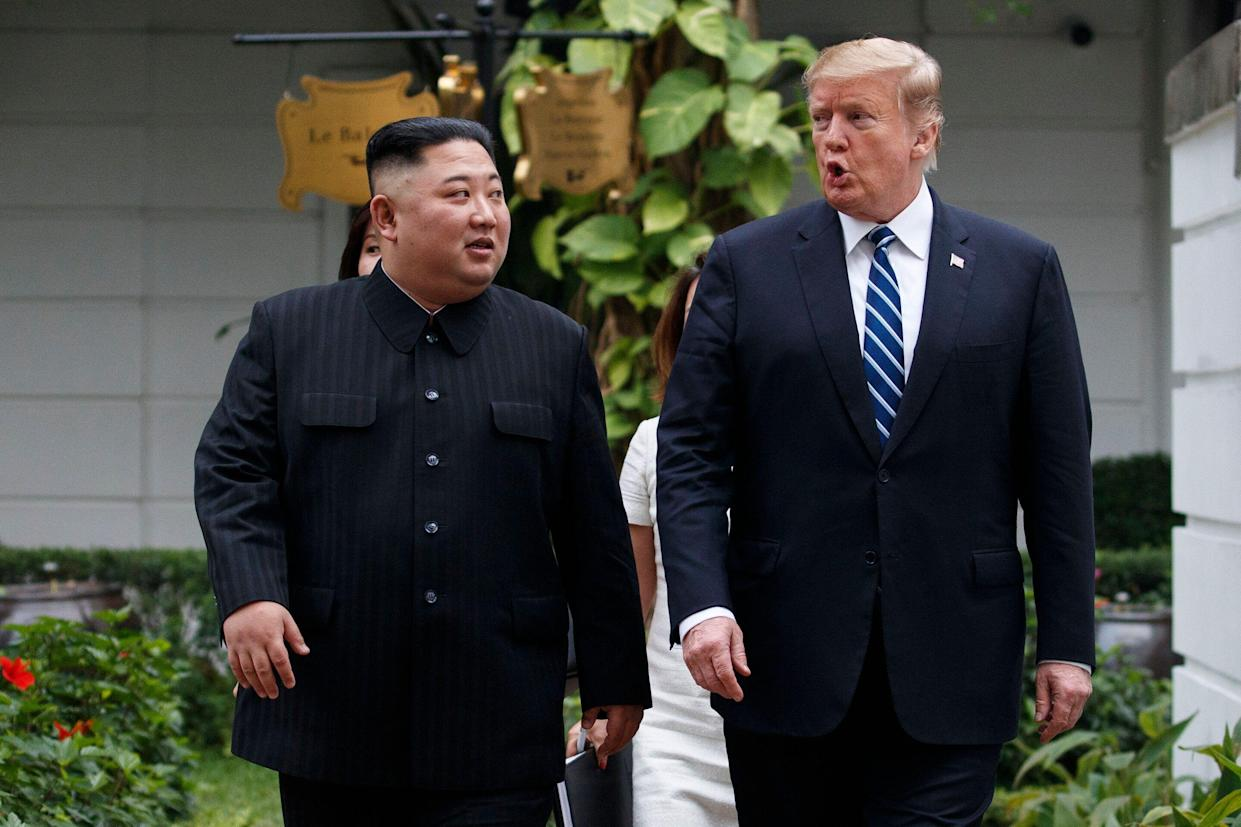 Kim and Trump take a walk after their meeting at the Sofitel Legend Metropole Hanoi hotel in February. (Photo: Evan Vucci/AP)