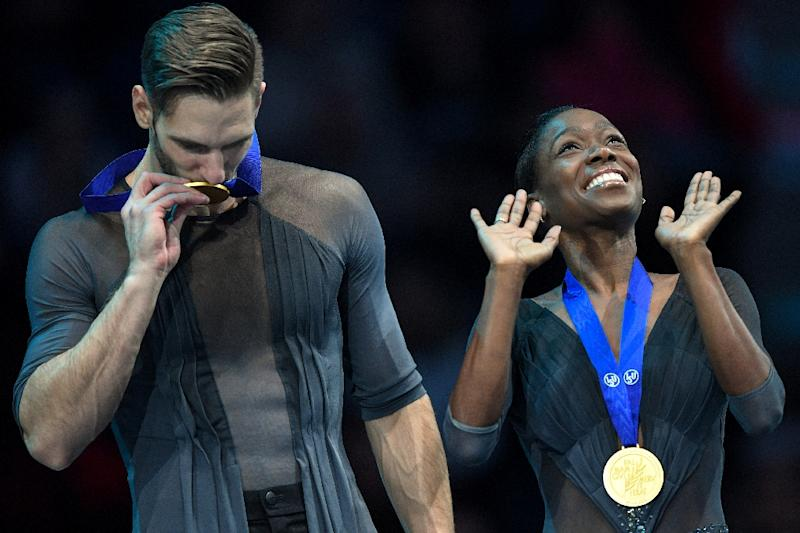 France's Vanessa James and Morgan Cipres celebrate with their gold medals