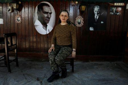 Businesswoman Dilsat Gulsevim Arinc, 68,  who says she will vote 'No' in the referendum, poses in her cafe in Cesme, in Izmir province, Turkey April 8, 2017.  REUTERS/Umit Bektas