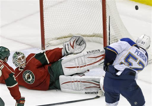 Minnesota Wild goalie Niklas Backstrom, of Finland, stops a shot by St. Louis Blues' David Perron, right, in the first period of an NHL hockey game on Thursday, April 11, 2013, in St. Paul. (AP Photo/Jim Mone)