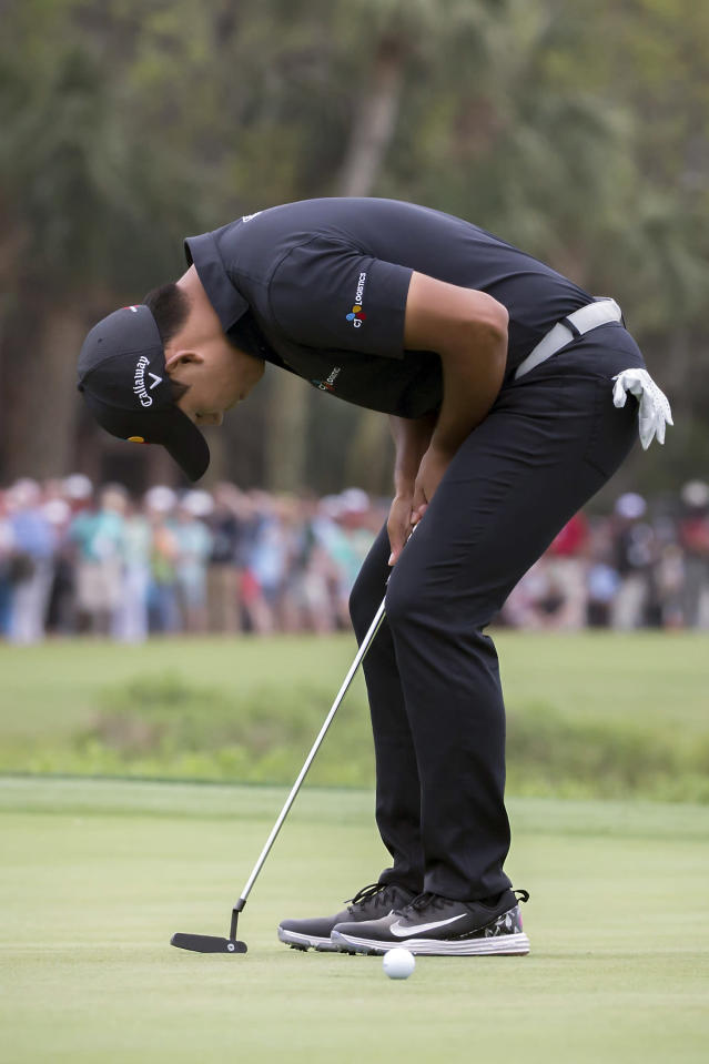 Si Woo Kim of South Korea reacts to missing a birdie putt on the 18th green during the final round of the RBC Heritage golf tournament in Hilton Head Island, S.C., Sunday, April 15, 2018. (AP Photo/Stephen B. Morton)