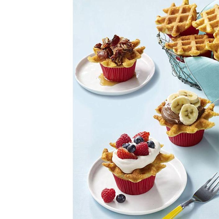 """<p>Add all his favorite toppings on these sweet breakfast cupcakes.</p><p><a href=""""https://www.womansday.com/food-recipes/food-drinks/recipes/a57925/wafflecakes-recipe/"""" rel=""""nofollow noopener"""" target=""""_blank"""" data-ylk=""""slk:Get the Wafflecakes recipe."""" class=""""link rapid-noclick-resp""""><em>Get the Wafflecakes recipe.</em></a></p>"""