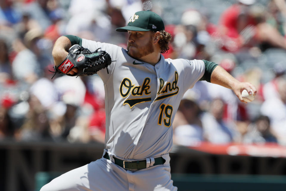 Oakland Athletics starting pitcher Cole Irvin throws to a Los Angeles Angels batter during the second inning of a baseball game in Anaheim, Calif., Saturday, July 31, 2021. (AP Photo/Alex Gallardo)