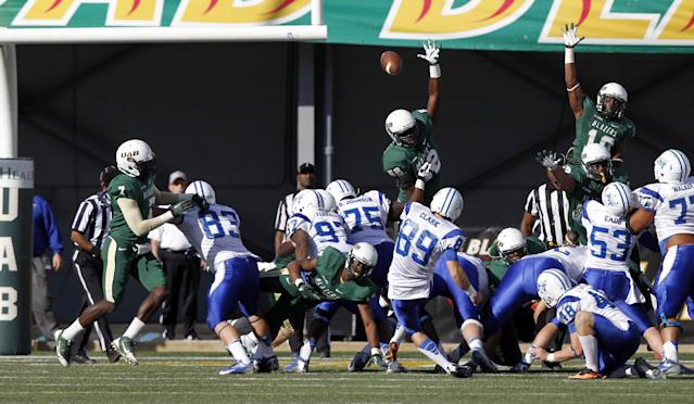 Middle Tennessee State kicker Cody Clark (89) kicks the winning field goal to beat UAB 24-21 during the second half of an NCAA college football game on Saturday, Nov. 2, 2013, in Birmingham, Ala. (AP Photo/Butch Dill)