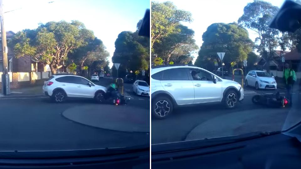 The two vehicles collided in the middle of a roundabout, knocking the scooter rider to the ground.