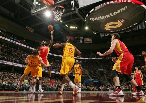 CLEVELAND, OH - JANUARY 5: James Harden #13 of the Houston Rockets tosses up the shot against Tyler Zeller #40 and Tristan Thompson #13 of the Cleveland Cavaliers at The Quicken Loans Arena on January 5, 2013 in Cleveland, Ohio. (Photo by David Liam Kyle/NBAE via Getty Images)