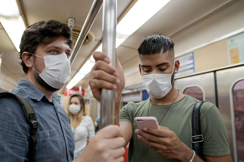 Officials recommend wearing a face mask when you can't practise physical distancing, such as on public transit. (Photo: Vergani_Fotografia via Getty Images)