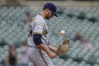 Milwaukee Brewers pitcher Jake Cousins (54) tosses a ball after allowing a Detroit Tigers' Dustin Garneau home run in the seventh inning of a baseball game in Detroit, Wednesday, Sept. 15, 2021. (AP Photo/Paul Sancya)