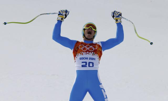 Italy's Christof Innerhofer reacts in the finish area after competing in the men's alpine skiing downhill race during the 2014 Sochi Winter Olympics at the Rosa Khutor Alpine Center February 9, 2014. REUTERS/Mike Segar (RUSSIA - Tags: SPORT OLYMPICS SPORT SKIING TPX IMAGES OF THE DAY)
