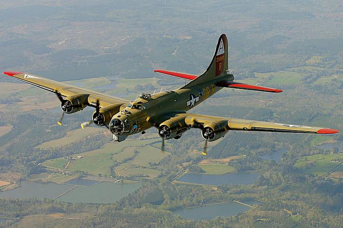 In this April 2, 2002, file photo, the Nine-O-Nine, a Collings Foundation B-17 Flying Fortress, flies over Thomasville, Ala., during its journey from Decatur, Ala., to Mobile, Ala. A B-17 vintage World War II-era bomber plane crashed Wednesday, Oct. 2, 2019,  just outside New England's second-busiest airport, and a fire-and-rescue operation was underway, official said. Airport officials said the plane was associated with the Collings Foundation, an educational group that brought its