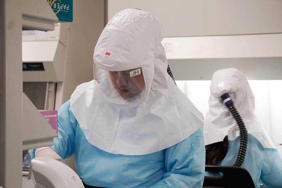 Home Team Science and Technology Agency (HTX) scientists demonstrating how the new COVID-19 test kit is used to detect the virus on 5 March 2020. (PHOTO: Dhany Osman / Yahoo News Singapore)