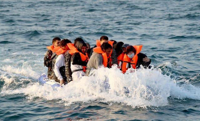 A group of people thought to be migrants crossing the Channel in a small boat headed in the direction of Dover, Kent