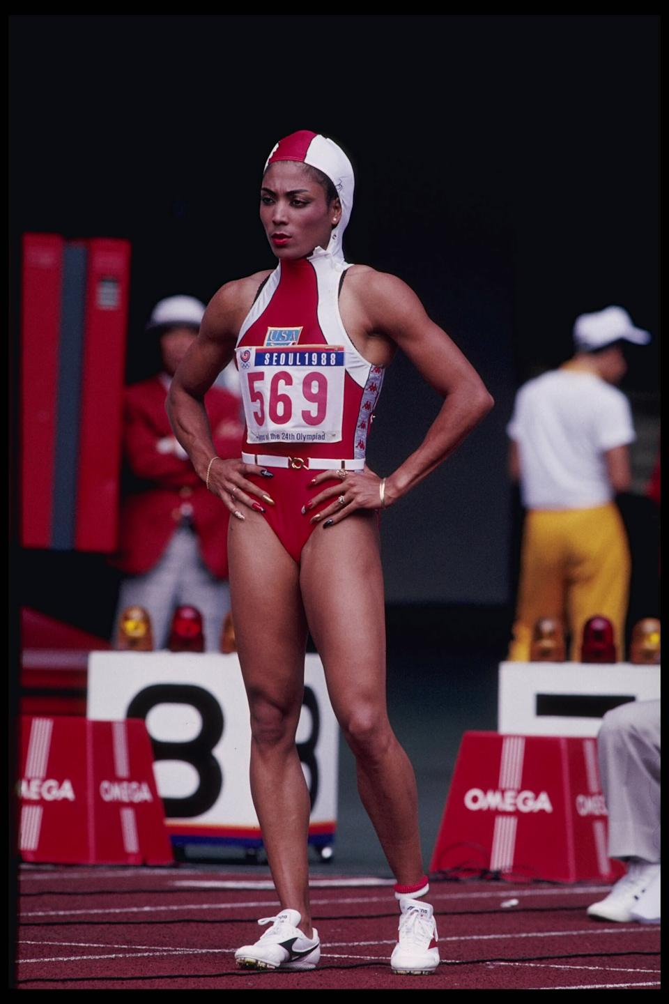 24 Sep 1988:  Florence Griffith-Joyner of the USA prepares for the 100m during the 1988 Summer Olympics in Seoul, Korea.  Griffith-Joyner went on to win the gold medal with a time of 10.54 seconds.  Mandatory Credit:  Tony Duffy/Allsport