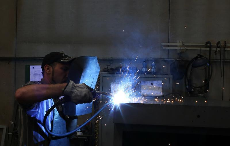 A worker welds in a factory in Gravellona Lomellina