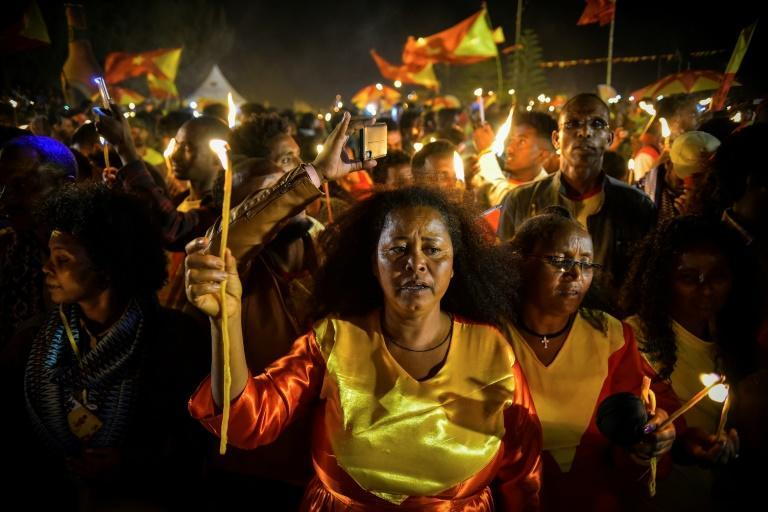 A candle-lit parade in Mekele, the capital of Tigray region, took place on the eve of celebrations for the founding of the TPLF, Ethiopia's once-dominant party (AFP Photo/MICHAEL TEWELDE)
