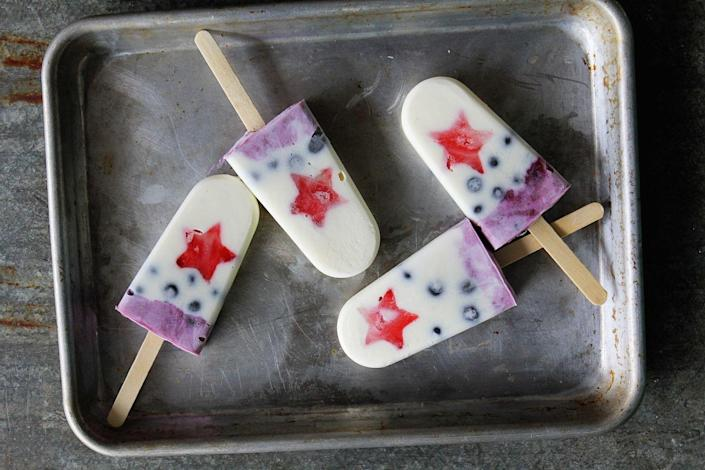 """<p>When the fireworks get you all hot and bothered, these colorful popsicles will cool you down.</p><p>Get the recipe from <a href=""""https://www.delish.com/cooking/recipe-ideas/recipes/a42973/firecracker-yogurt-pops/"""" rel=""""nofollow noopener"""" target=""""_blank"""" data-ylk=""""slk:Delish"""" class=""""link rapid-noclick-resp"""">Delish</a>.</p>"""