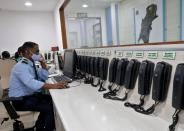 A staff member attends calls inside the disaster management war room set up by BMC, in Mumbai