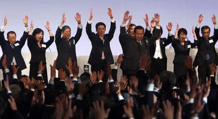 File picture shows Japan's Prime Minister Shinzo Abe with his hands in the air during the annual Liberal Democratic Party convention in Tokyo