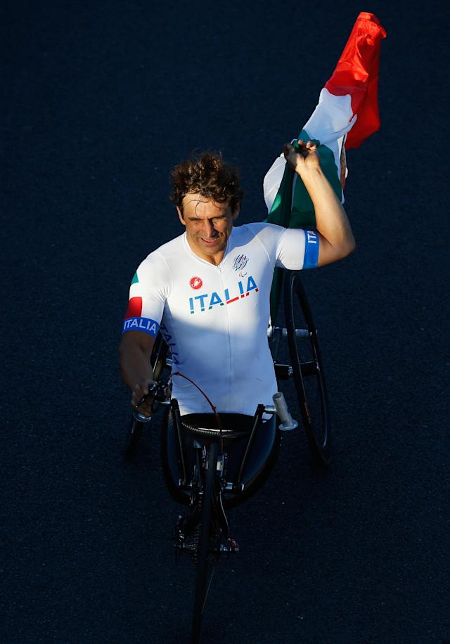 LONGFIELD, ENGLAND - SEPTEMBER 07: Alessandro Zanardi of Italy celebrates after winning Gold in the Men's Individual H 4 Road Race on day 9 of the London 2012 Paralympic Games at Brands Hatch on September 7, 2012 in Longfield, England. (Photo by Harry Engels/Getty Images)