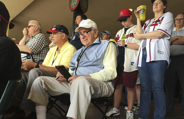 FILE - In this March 5, 2016, file photo, Tommy Giordano, special assistant to the general manager of the Atlanta Braves, scouts a spring training baseball game between the Braves and the Pittsburgh Pirates, in Kissimmee, Fla. I'm going to do this until I die, Giordano told me back in 2016, when I first met him at the Braves spring training complex, located within the confines of Disney World. I can't wait to get up in the morning and go to the ballpark. (AP Photo/Paul Newberry, File)