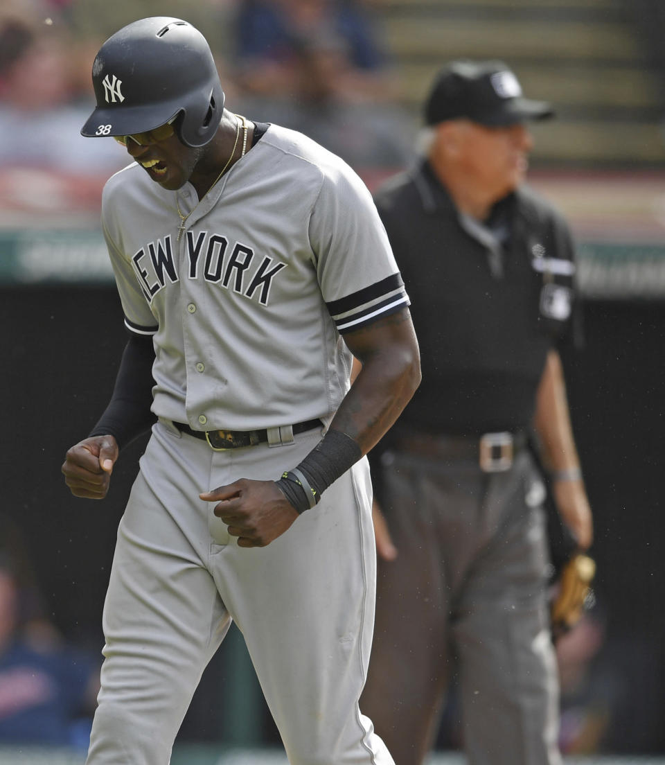 New York Yankees' Cameron Maybin celebrates after scoring on a double by Aaron Hicks in the tenth inning of a baseball game against the Cleveland Indians, Sunday, June 9, 2019, in Cleveland. The Yankees won 7-6. (AP Photo/David Dermer)