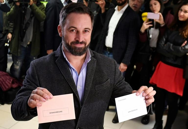 Vox's far-right candidate Santiago Abascal poses with his ballots in Madrid as his party looks for a surge in support
