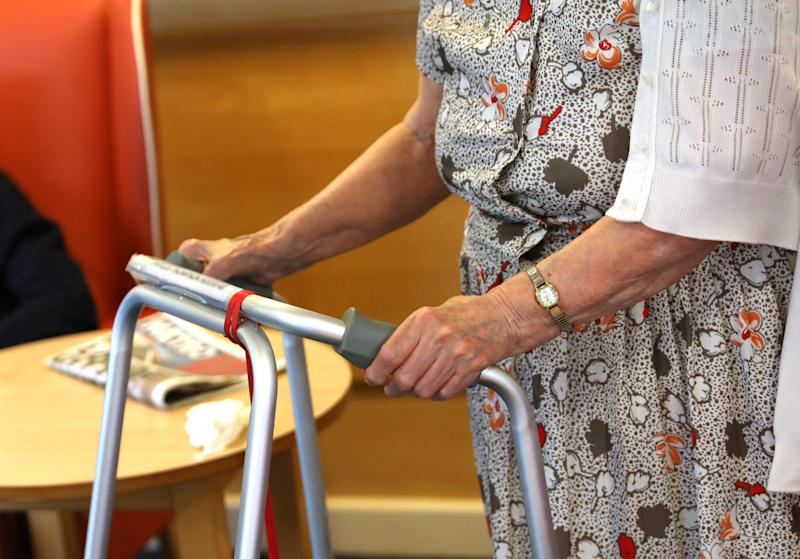 An elderly woman holds to a walking frame at a nursing home in south London, as research has revealed that care home residents were more likely to die of Covid-19 in the UK than in any of the major European countries apart from Spain. Picture date: Wednesday July 1, 2020.