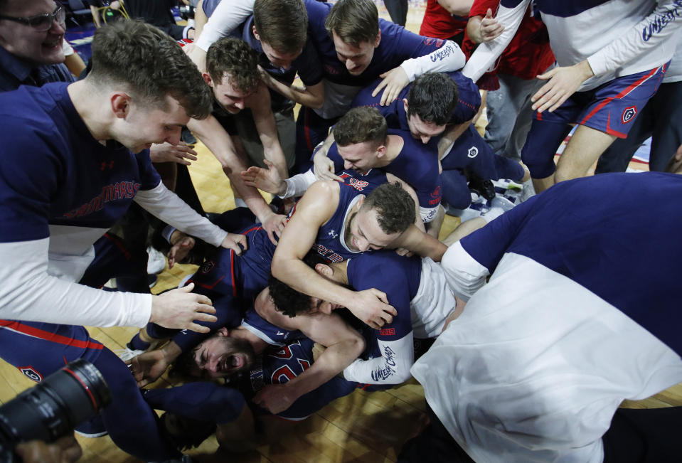 St. Mary's celebrates after defeating Gonzaga 60-47 in an NCAA college basketball game for the West Coast Conference men's tournament title, Tuesday, March 12, 2019, in Las Vegas. (AP Photo/John Locher)
