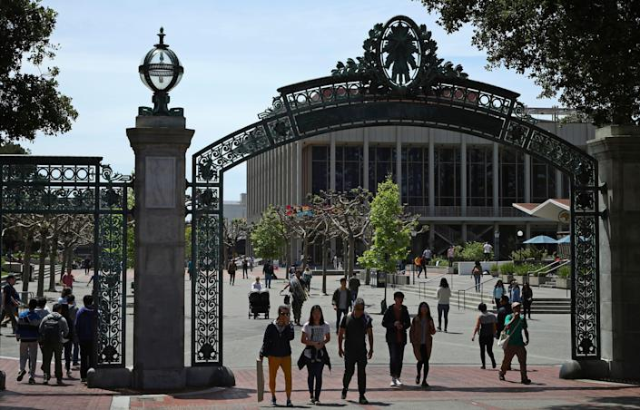 Students walk past Sather Gate on the University of California at Berkeley campus.