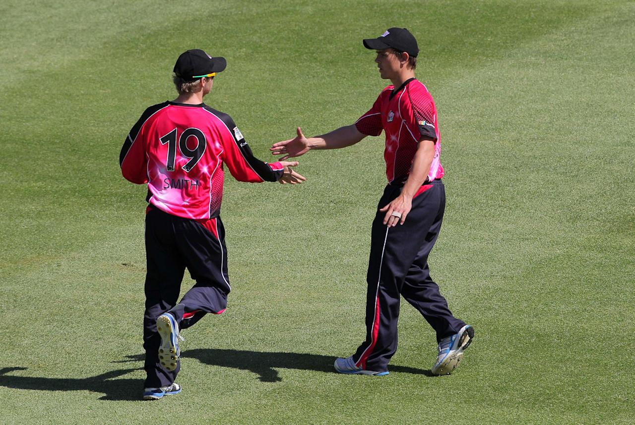 CAPE TOWN, SOUTH AFRCA - OCTOBER 16:  Steven Smith and Stephen O'Keefe of the Sydney Sixers celebrate during the Champions League twenty20 match between Sydney Sixers (Australia) and Yorkshire (England) at Sahara Park Newlands on October 16, 2012 in Cape Town, South Africa. (Photo by Carl Fourie / Gallo Images/Getty Images)