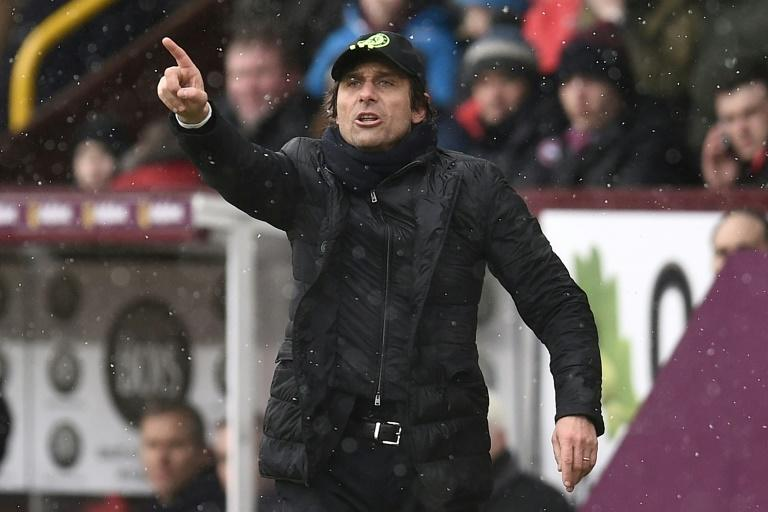 Chelsea's Italian head coach Antonio Conte gestures on the touchline during the English Premier League match between Burnley and Chelsea at Turf Moor in Burnley on February 12, 2017