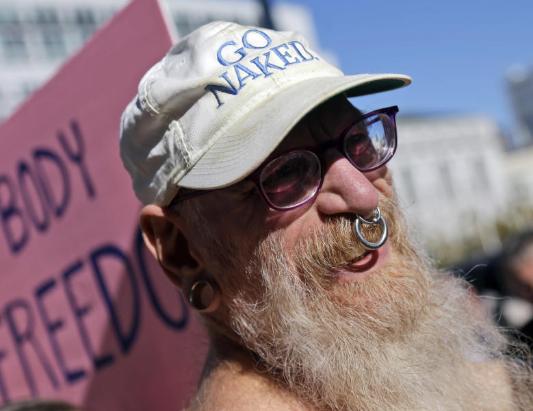 Woody Miller attends a rally in opposition to a city-wide nudity ban outside of City Hall in San Francisco, Wednesday, Nov. 14, 2012. San Francisco appears poised to shed part of its image as a city where anything goes, including clothing. The Board of Supervisors is scheduled to vote next week on a law that would ban public nudity. The proposal comes in response to a devoted group of nudists who proudly strut their stuff through the city's Castro District. (AP Photo/Marcio Jose Sanchez)