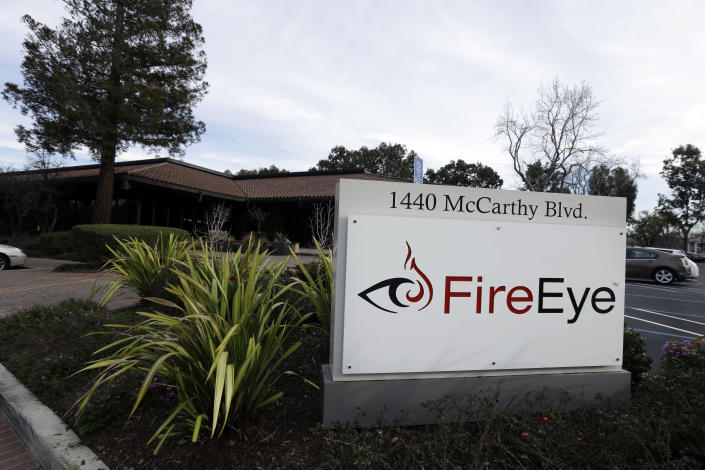 FILE - This Wednesday, Feb. 11, 2015 file photo shows FireEye offices in Milpitas, Calif. Experts say it's going to take months to kick elite hackers widely believed to be Russian out of U.S. government networks. The hackers have been quietly rifling through those networks for months in Washington's worst cyberespionage failure on record. FireEye is the cybersecurity company that discovered the worst-ever intrusion into U.S. agencies and was among the victims. It has already tallied dozens of casualties. It's racing to identify more. (AP Photo/Ben Margot)